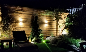 back patio with wall lighting