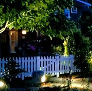 house lit up with picket fence