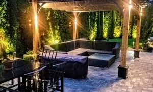 arbor with lighting and patio lounge